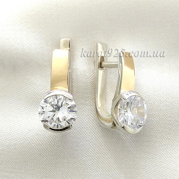 Сережки срібні з золотими вставками з одним камінчиком
