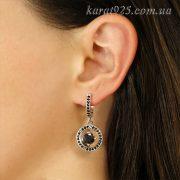 Срібні сережки з золотою вставкою та чорним камінчиком